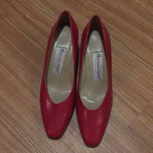 A Etienne Aigner women high heel shoe.